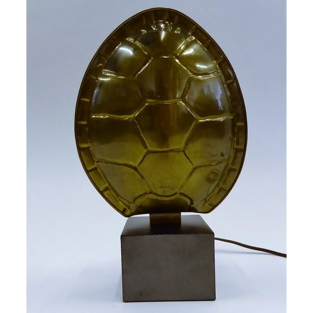 By the Chapman Lamp Co. from 1978, a dark patinated mid-century modern brass turtle shell lamp. Standing on a black metal...