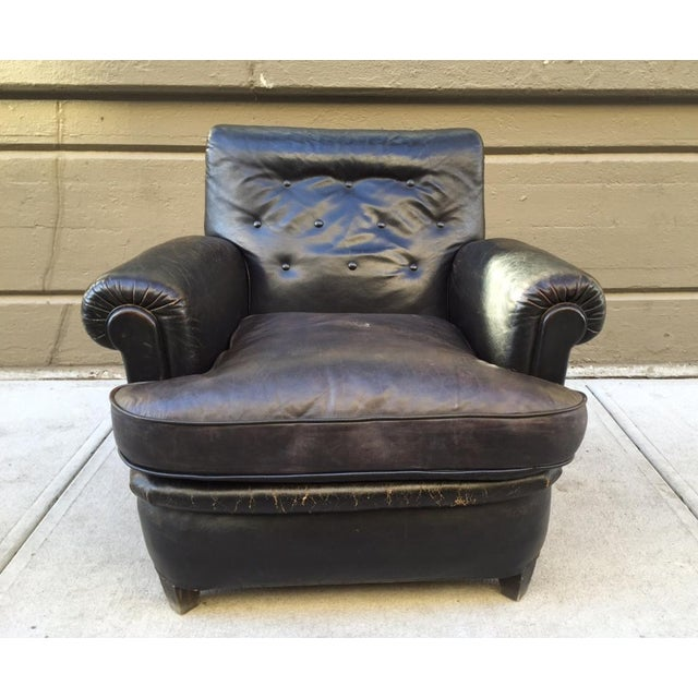 Pair of 1930s English leather club chairs. Has wood bracket feet. In original vintage condition.