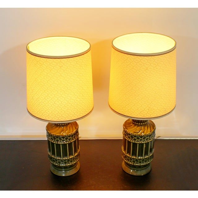 For your consideration is a small but striking pair of ceramic table lamps, circa the 1960s. Includes original shades and...
