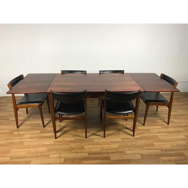 Stunning Danish Rosewood dining set table and six chairs,upholstered in a classic black vinyl,the rosewood frame on the...