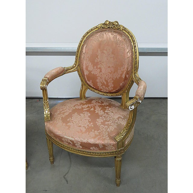 """Pair of French Regency style arm chairs with an 18"""" seat height."""
