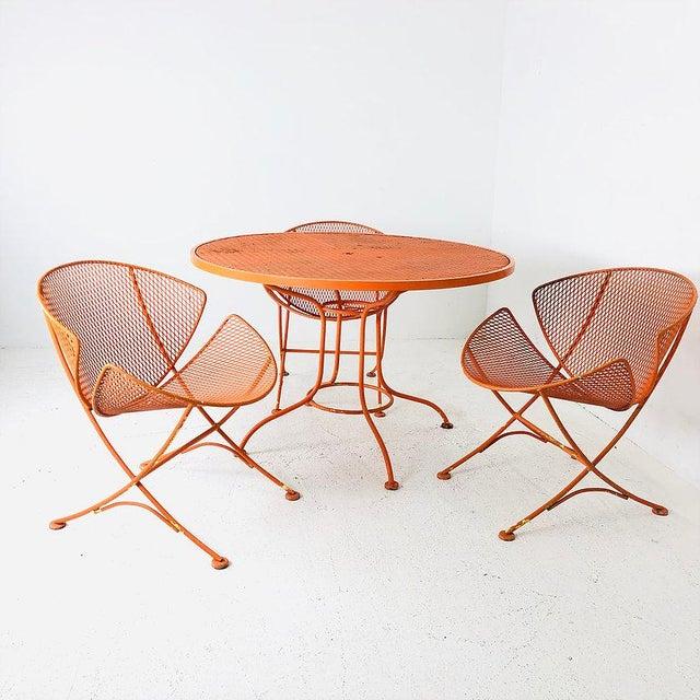 """Set of Three Mid-Century Salterini """"Orange Slice"""" Chairs & Table Orange Metal Patio Set."""