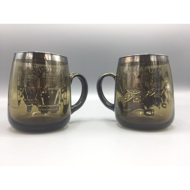Rare pair of silver rim and handle smoke glass mugs with silver Mesoamerican (Aztec, Mayan or Incan) design overlay on...