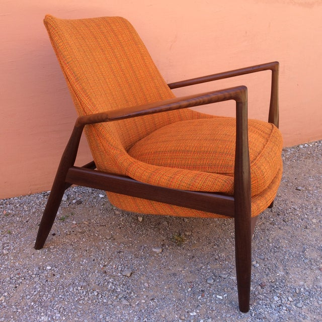 This is an early rare issue 'Seal' easy chair designed by Ib Kofod-Larsen. This is a true collector chair! It has the...