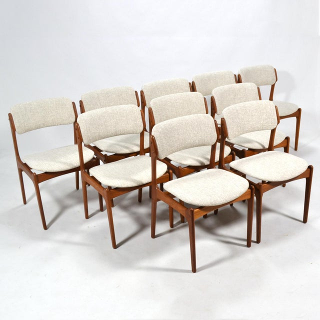 Handsome set of ten teak dining chairs by Erik Buch for O.D. Mobler. Newly upholstered in a beautiful linen fabric.