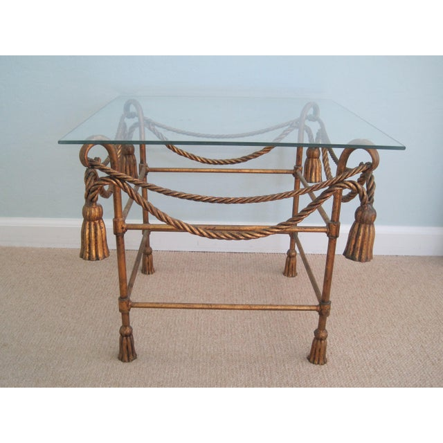 Elegant and highly collectible Hollywood Regency side table. Rope swags wrap around the table with large lovely tassels...