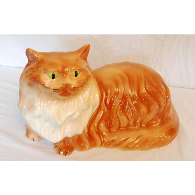 Large beautiful orange long hair cat with green eyes. This charming ceramic Tabby cat has a high gloss finish and is in...