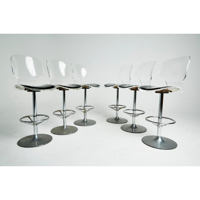 These Classic Mid-Century Lucite bar stools by Hill Manufacturing were created in the style of Charles Hollis Jones with...