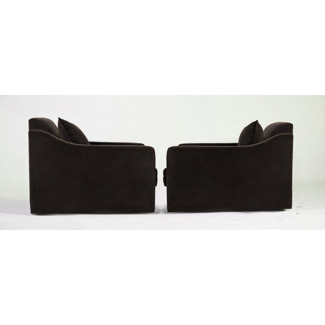 Fully upholstered in a plush chocolate, mink toned velvet . Nice proportions with a down pillow. These world class lounge...