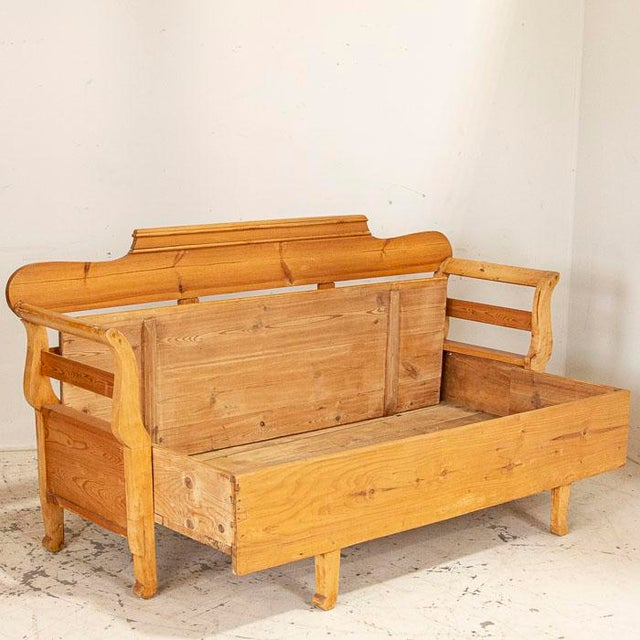 """This style of Swedish bench was formerly known as a """"maid's bed."""" This bench was originally designed as a type of """"spare..."""