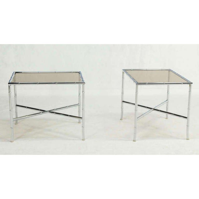 Pair of mid century modern faux bamboo end tables.