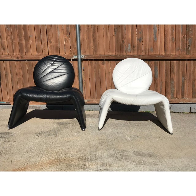 Pair of Vintage Black and White Italian Leather Lounge Chairs are curvy and add a retro vibe to any decor. Very RARE and...
