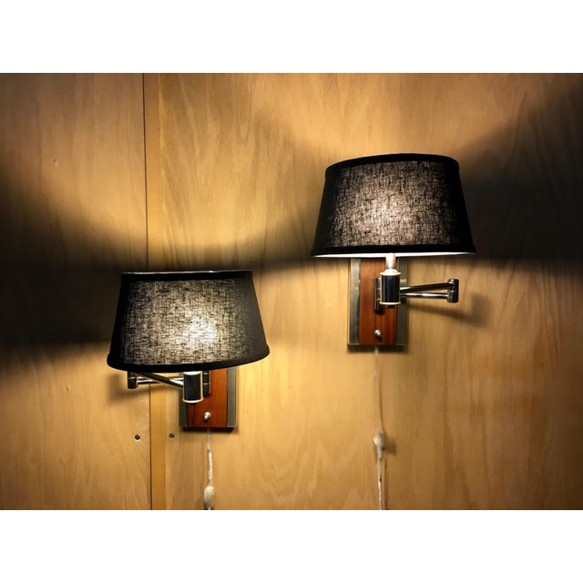 20th century sconces with solid walnut base and chrome arm and side accents and black linen shades
