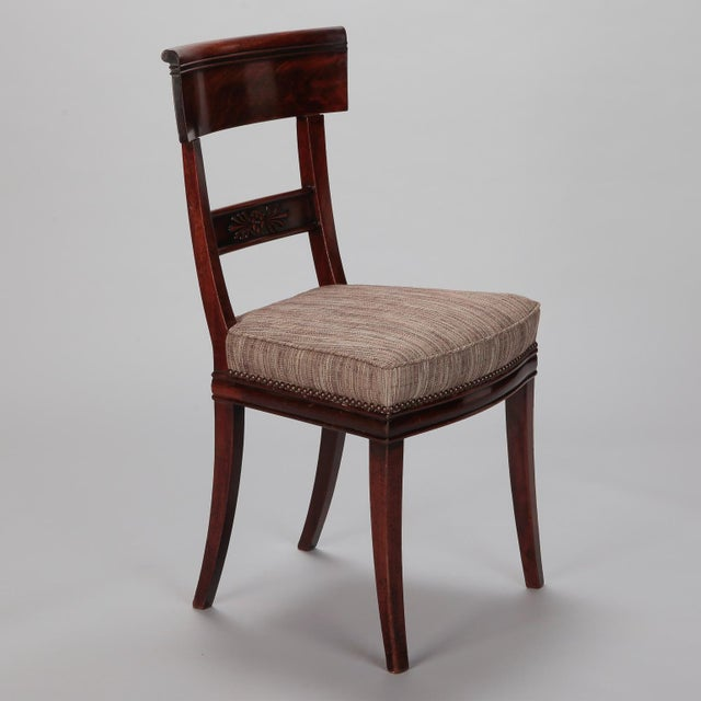 Circa 1825 set of six French dining chairs with newly upholstered seats and carved walnut frames. Newly upholstered in...