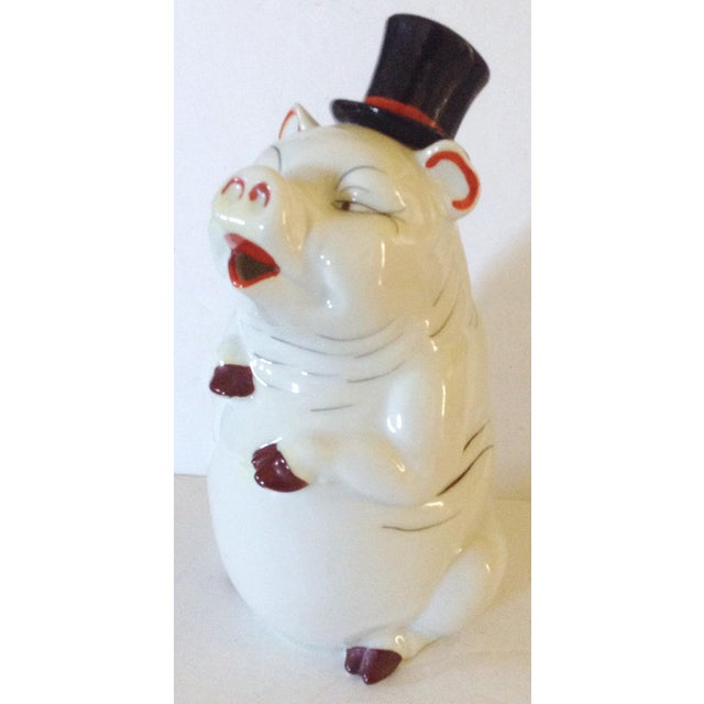 This charming pig decanter was made in Japan and his top hat is the cork and your beverage of choice pour from his mouth.