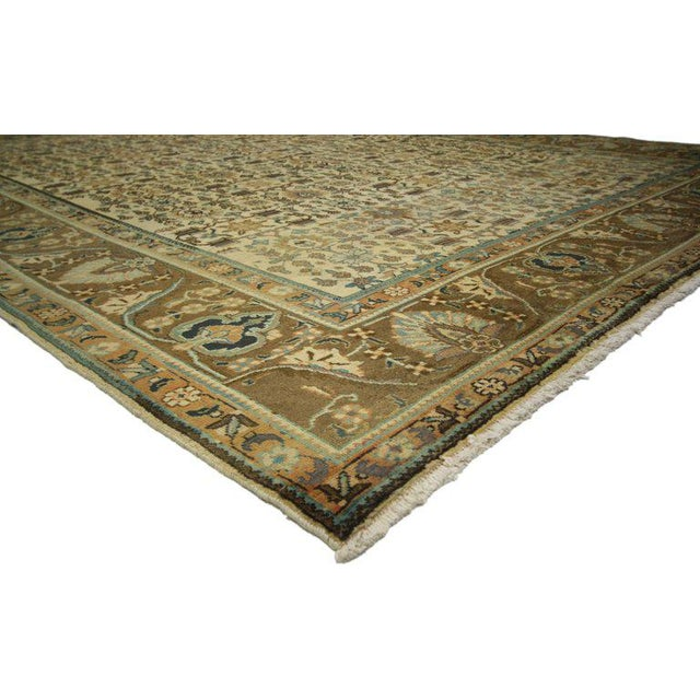 76360, vintage Persian Tabriz rug 09'08 x 12'07. This hand-knotted wool vintage Persian Tabriz rug features an all-over...