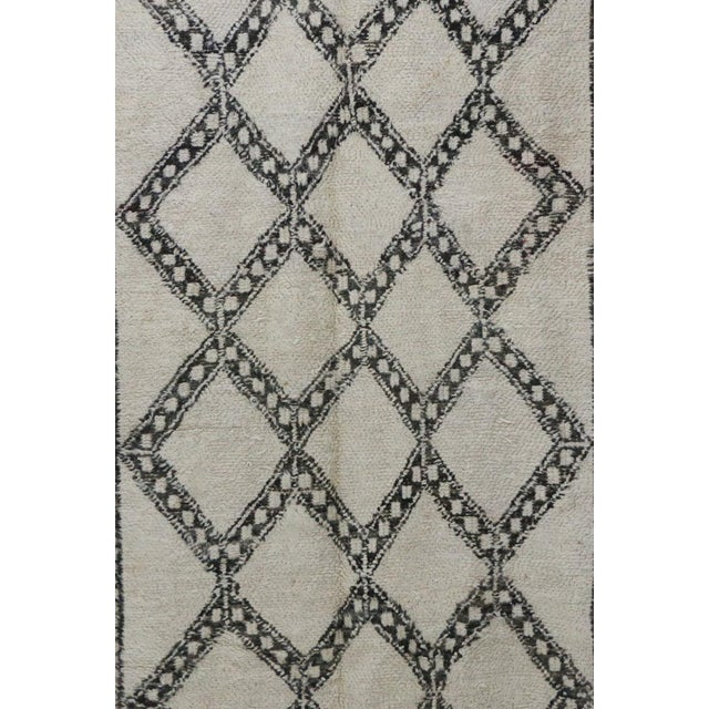 Beni Ourain - or Beni Ouarain - rugs are one of a kind Berber rugs made in the Middle Atlas Mountains of Morocco....