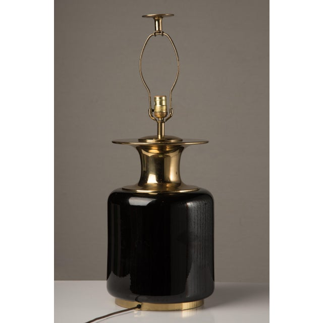 Large, stunning Chapman black ceramic and brass table lamp. Made in the 1950s. Original finial.