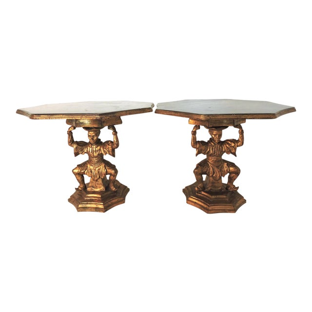 A pair of stunning Chinoiserie style figural Italian side tables with beautifully hand crafted woodwork. This pair of...