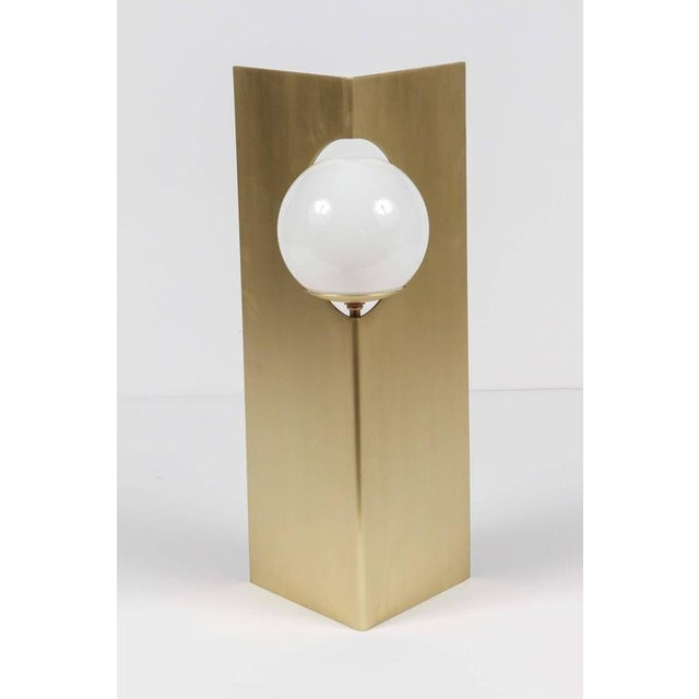 Paul Marra Solitaire Desk or Table Lamp shown in unlacquered brushed brass. The brass is unlacquered so it will age...