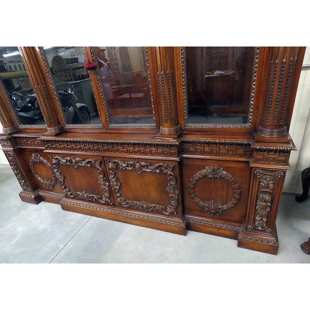 Georgian style mahogany eight-door breakfront with floral and Greek key motif.
