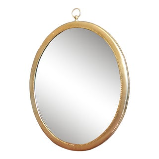 Distressed Gilded Oval Wall Mirror For Sale