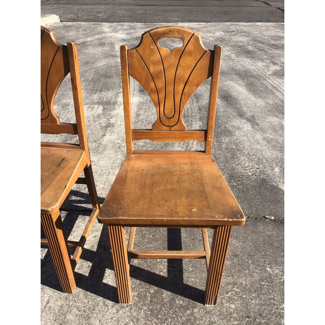Charming rustic set of 4 informal side dining chairs having sturdy wooden seats and frames with stylish art deco style...