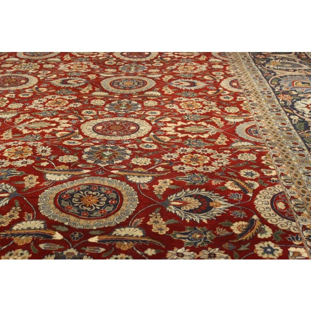 Add a burst of vibrant colors to your home interior with this beauteous hand knotted Pak-Persian rug made by talented...
