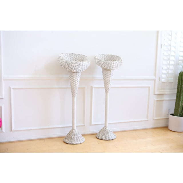 These vintage white wicker basket fan flower stands were used for weddings to display the floral arrangements. The shabby...