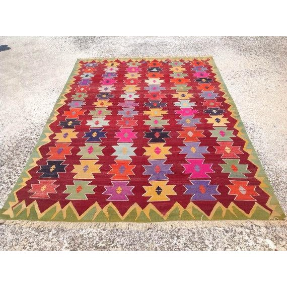 This beautiful, vintage, handwoven kilim is approximately 50 years old. It is handmade of very fine quality hand spun wool...