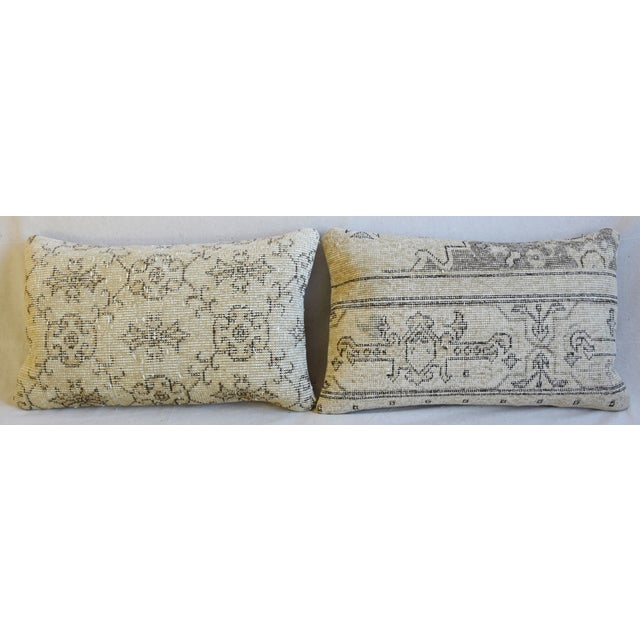 Pair of custom-tailored one-of-a-kind pillows created from antique/professionally dry-cleaned hand-woven/knotted wool...