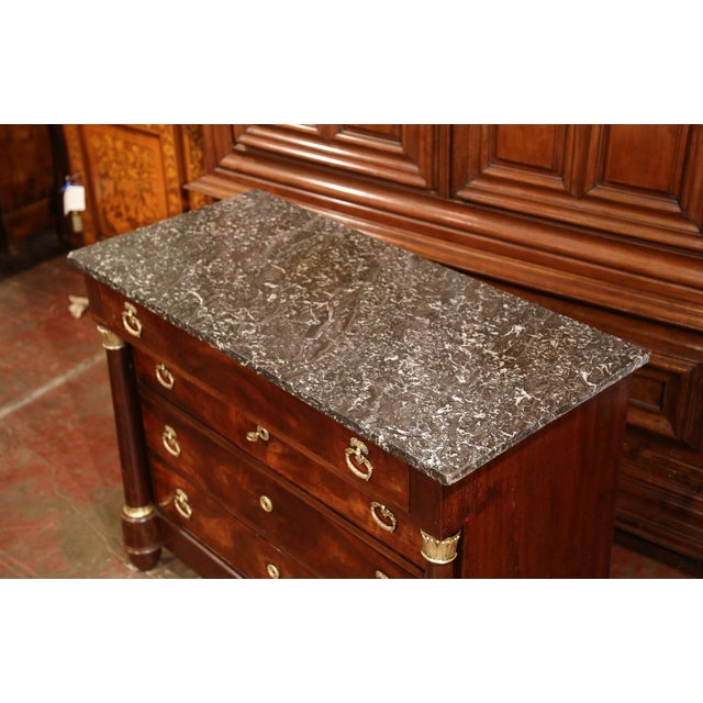 This elegant, antique fruit wood chest of drawers was crafted in France, circa 1830. The traditional commode features...