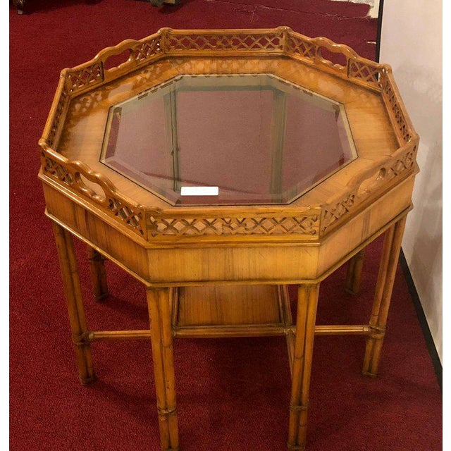 Maitland Smith bamboo form octagon shaped end / lamp table with bevelled glass. Having an insert glass bevelled tabletop...