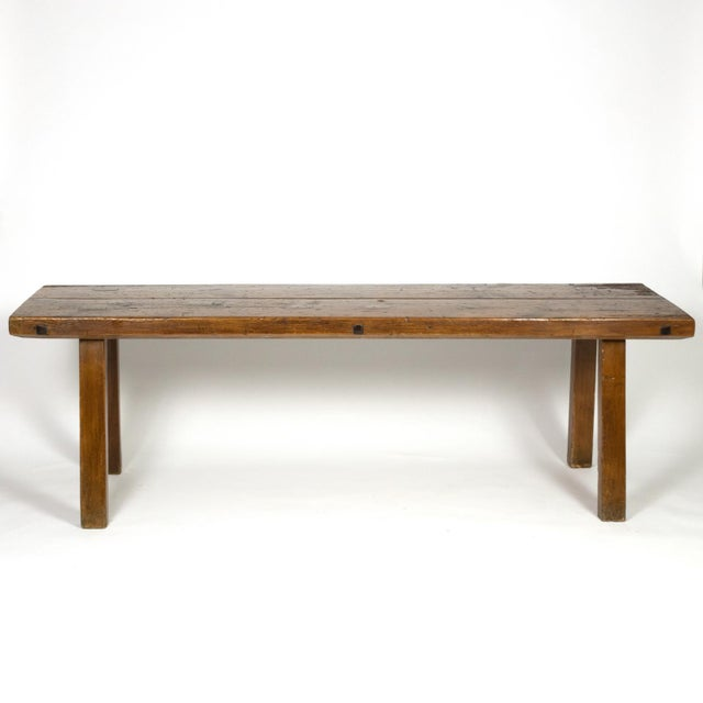 Rustic Elm work bench with square iron pegs, English circa 1880; with substantial and sturdy plank top, bevel edges, hand...