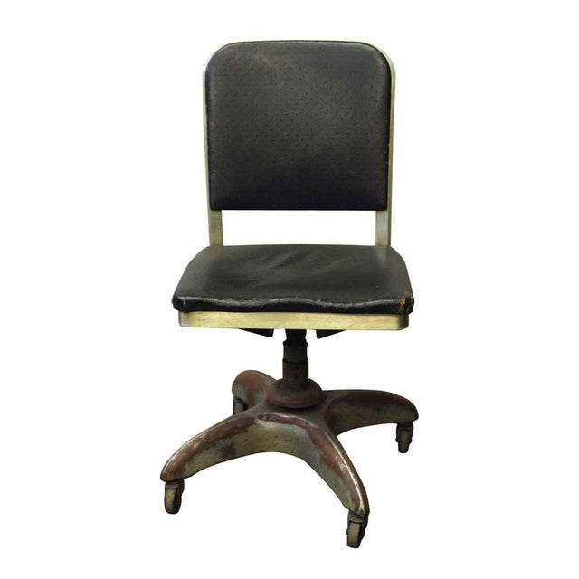 Steel rolling office chair with comfort at its best. The black upholstery is intact with reasonable wear at the corners...