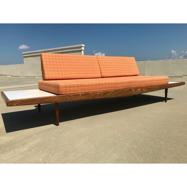 Stunning Mid-Century Modern platform sofa in style of Adrian Pearsall. Wonderful sofa that has been reupholstered with new...