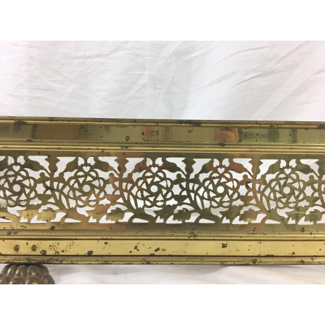 This brass fender has lovely lace-cut roses and thistles and unexpected lion's feet. Dates from ca. 1915. In good...
