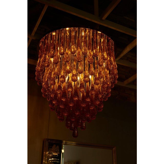 Monumental brass and amber Murano glass tear drop flush mount or chandelier attributed to Barovier & Toso. The extra huge...