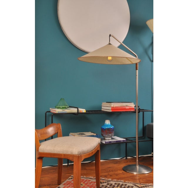 A telescopic floor lamp with China hat form lampshade made inhouse by Rayon Roskar. The central stem retails the original...
