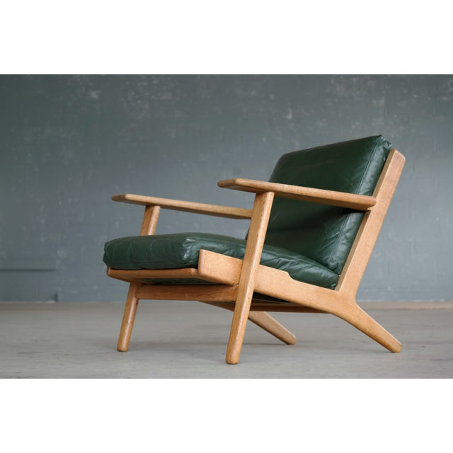 Sought after low back lounge chair model GE290 designed by Hans Wegner for Getama in 1953. The GE290 his is one of...