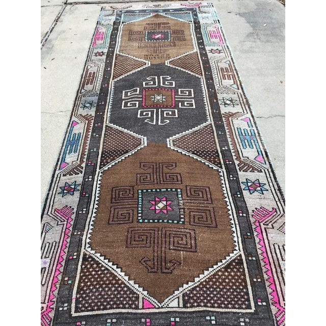 This is a vintage Turkish rug runner. The piece was hand-knotted in the 1970s.
