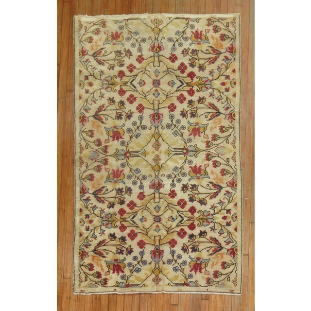 A Mid Century, one of a kind, Turkish, Anatolian rug that features a beige field and accents in brown and red.