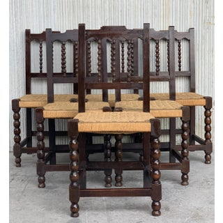 20th Century Set of Eight Catalan Chairs/Armchairs in Walnut and Caned Seats Preview