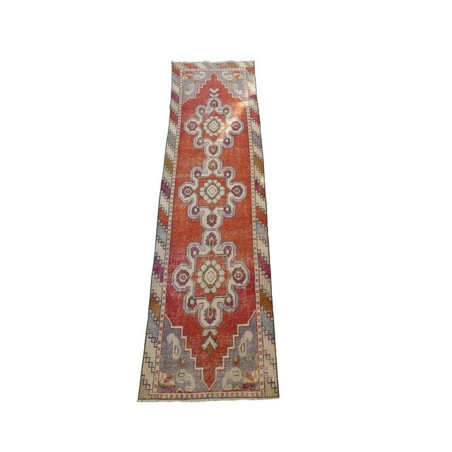 This is a unique vintage runner rug that would be a nice rug for any collection! The piece was made in the 1970s....