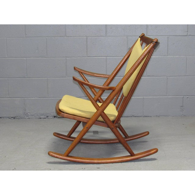 Danish teak rocking chair by Frank Reenskaug for Brahmin with loose cushions.