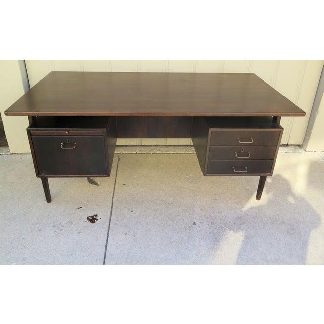 Torben Strandgaard teak and oak Danish Modern desk with floating top. 3 right drawers, 1 left filing cabinet drawer, and...