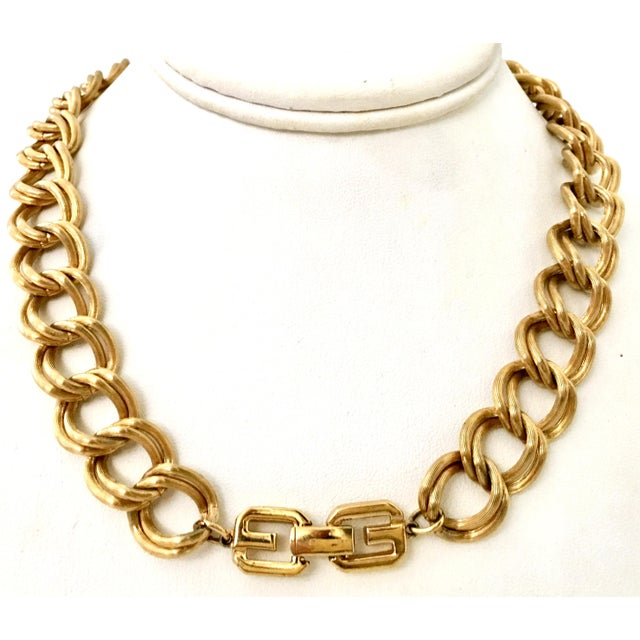 """Contemporary Givenchy Gold Plate """"GG"""" Logo Double Chain Link Choker Style Necklace. The """"GG"""" logo fold over box style..."""