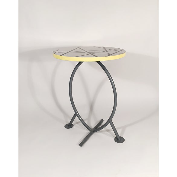 Cairo Table. Michele DeLucchi for Memphis. Tubular steel base, laminate and lacquered wood top.