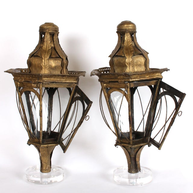 Pair of 19th century Italian iron processional lanterns, each with six sides of glass protected by iron cages, a working...