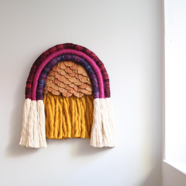 Hand wrapped cotton in gorgeous red, magenta, gold, and violet wool with handwoven full grain leather detail. Signed by...